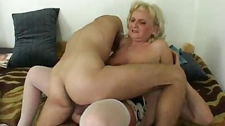 Two young men are fucking with a MILF